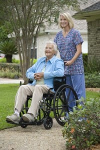 nurse pushing woman through senior hospice care services
